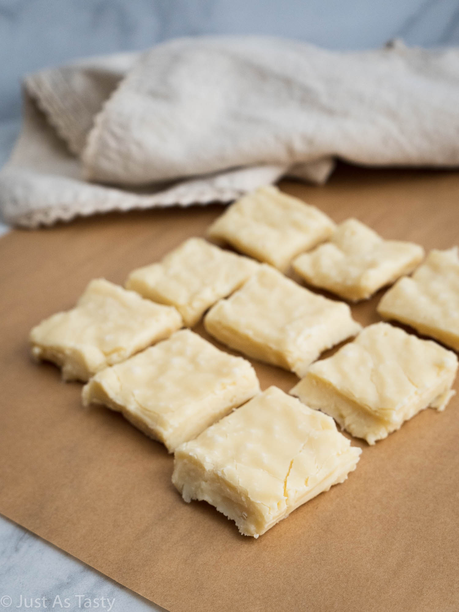 Sliced up fudge on brown parchment paper.
